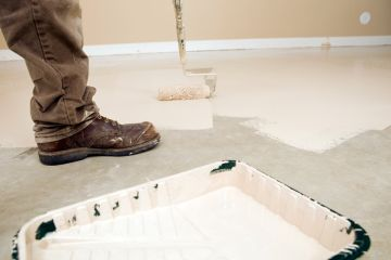 Painter painting garage floor in Brentwood