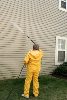 Pressure washing the siding of a house by Mario's Painting & Home Maintenance, LLC.