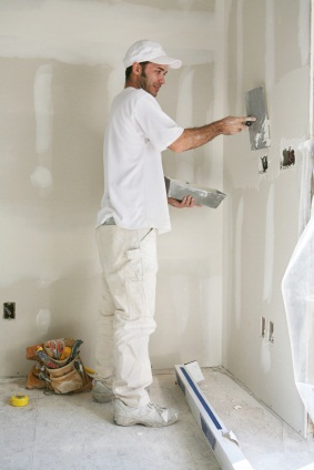 Drywall repair being performed by an experienced Mario's Painting & Home Maintenance, LLC drywall technician.